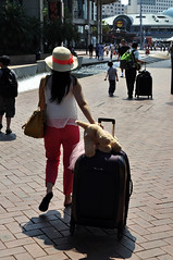 Family on the move (Roving I) Tags: travel tourism boys vertical asians families sydney australia tourists luggage baggage teddybears softtoys redtrousers sunhats