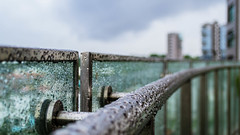 Chilling (Alpha Beta Photography) Tags: sky building home water glass rain clouds droplets drops high singapore asia southeastasia apartments view balcony panes rail patio rails railing