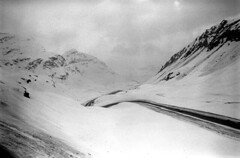 04a3471 21 (ndpa / s. lundeen, archivist) Tags: nick dewolf nickdewolf bw blackwhite photographbynickdewolf film monochrome blackandwhite april 1971 1970s 35mm europe centraleurope switzerland swiss alpine alps graubünden grisons easternswitzerland suisse schweitz mountains peaks snow snowy snowcovered landscape swissalps road highway ontheroad roadtrip