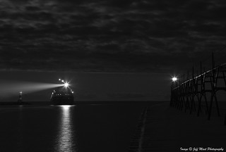 Laker Manistee arriving at Manistee, Mi. under a Full Moon above low clouds