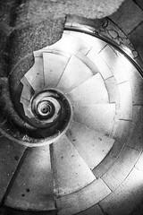 Spiral Down (laurenspies) Tags: barcelona eixample europe spain catalunya sagradafamília lasagradafamilia staircase stairs spiralstaircase blackandwhite blackwhite gaudí architecture