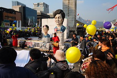 "Seoul Korea Kwanghwamun candle rally March 4 2017 with stage performances in front of effigy - ""Korean Spring"" (2) (moreska) Tags: seoul korea kwanghwamun candle rally protest demonstration march 4 2017 impeachment socialchange history democracy freespeech balloons effigy caricature stage performance hangul banner slogan crowd unstaged candid photoop afternoon plaza 광화문 capital 대한민국 rok asia"