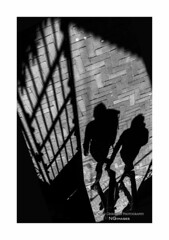 Through The Gate (Nico Geerlings) Tags: ngimages nicogeerlings nicogeerlingsphotography streetphotography silhouette reflection rijksmuseum amsterdam holland netherlands leicammonochrom 50mm summilux
