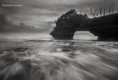 Nature in monochrome... (segokavi) Tags: bali tanahlot sea seascape sunset beach rocks motion waves arch nature landscape indonesia