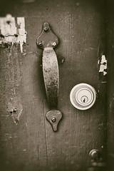 the lock (annapolis_rose) Tags: vancouver bw door doorway alley doorhandle lock