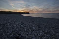 Sunset At Penmon Point (ereid88) Tags: penmonpoint wales pebbles pebbled uk clouds sunset isleofanglesey
