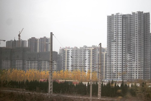 Semi-inhabited housing units in Jinan overlooking the train station