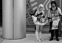 Cosplay Smoke Break (burnt dirt) Tags: houston texas downtown city town mainstreet street sidewalk streetphotography fujifilm xt1 bw blackandwhite girl woman people person animae cosplay costume uniform matsuri convention smoke smoking vape vapor ecigarette cigarette man couple pair blonde purse bag lighter lightingup cheerleader harleyquinn stockings kneehigh whitestockings longhair longgloves gloves stansmith belly shortskirt standing discoverygreen georgerbrown
