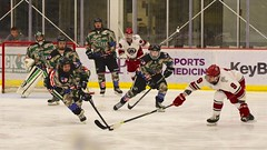 Str...et...ch...ing.... (R.A. Killmer) Tags: acha sru green white puck stick skate leap competition ice hockey tough grit deflect shot