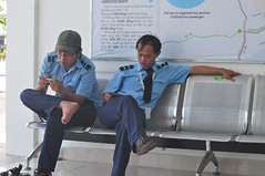 Down time (Roving I) Tags: busdrivers relaxing downtime barefeet nikeswoosh smartphones signs terminal depots uniforms stainlesssteel metalseats seating concentration colleagues danabus danang vietnam publictransport