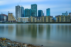 City of Glass, Steel and Silky river... (Aleem Yousaf) Tags: overcast clouds architecture buildings office skyscrapers hotel novotel construction cranes glass steel silky river long exposure london visitlondon canary wharf big stopper lee filter neutral density thames reflections