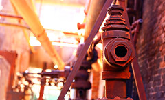 Rusty Beauty (Samantha Evans of Samantha Evans Photography) Tags: rust metal corrosion red orange pipes bolts mechanism machinery slossfurnaces iron smelt furnace birmingham birminghamal al alabama brick wall building sunlight dof shallowdepthoffield shallowdof nationalhistoriclandmark