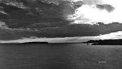 The eye of the sky (RoyBatty83) Tags: pentax penta pentaxiani k5 pentaxda1855wr pentaxk5 da1855wr wr 1855 pentaxda1855alwr filter ndfilter lake laketrasimeno water umbria perugia trasimeno polvese polveseisland isolapolvese isola tramonto sunset tramontosullacqua blackandwhite biancoenero bw monocromo blackwhite bn elements nature naturephotography clouds cloudysky sky cloudy