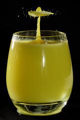 A refreshing drink (Andy Coe) Tags: macro art water glass yellow drink sony drop impact splash alpha a77 splashart