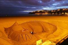 Sandy dragon in Getxo beach (Mimadeo) Tags: ocean summer vacation sculpture castle art beach statue architecture coast construction sand candle dragon sandy figure leisure sandcastle seashore begging tramp nigth wanderer beg vagabond getxo