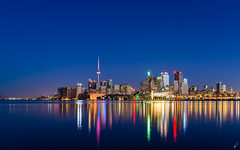 Graduation (Empty Quarter) Tags: city longexposure blue urban panorama toronto canada reflection water skyline dawn lights pier twilight nikon downtown cityscape cntower view 28mm cbd f18 core d600 polson