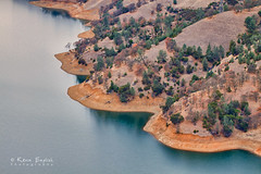 Lake Berryessa (Kevin English Photography) Tags: california county trees winter usa brown lake cold reflection green water forest season rocks quiet smooth shoreline scenic peaceful surface calm hills shore valley drought napa serene sacramento recreation berryessa