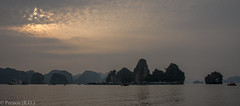 Sunset over Halong Bay, Vietnam (Peraion) Tags: sea sun boats rocks asia hills vietnam cluds halongbay