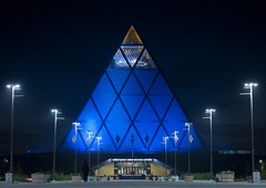 Palace Of Peace And Reconciliation By Night, Astana, Kazakhstan (Eric Lafforgue Photography) Tags: lighting blue people building monument horizontal architecture night outside outdoors person exterior nightshot pyramid streetlamps streetlights capital structure nightview centralasia kazakhstan kazakh modernarchitecture humanbeing sights easterneurope astana brianclarke streetlighting fosterandpartners palaceofpeaceandreconciliation akmola akmolinsk kz8311