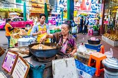 Busy Bangkok street corner with asian woman cooking on wok. (JJ Doro - Bangkok) Tags: asian bangkok busy asia cooking corner street streetcorner wok woman seasia rice streeetfood cook busycorner thailand thai thaifood