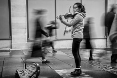 the girl with the magical violin (Daz Smith) Tags: chosen dazsmith fujixt20 fuji xt20 andwhite bath city streetphotography people candid canon portrait citylife thecity urban streets uk monochrome blancoynegro blackandwhite mono gilr violin busker performer music ghosts faceless blurred blur