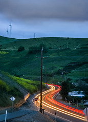 duck and weave (pbo31) Tags: livermore eastbay alamedacounty country color april 2017 spring boury pbo31 nikon d810 sky bayarea lightstream motion green altamontpass roadway traffic valley curve over turbines windfarm power energy earth 580