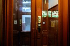 Red Doorway at Night (Zach K) Tags: red doorway night reflection reflectors nyc chinatown new york city door hallway apartment building fuji xt1 35mm hk wonton garden nighttime frontdoor 79 mulberry street sign signage