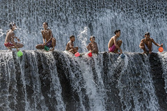 Boys at play (tmeallen) Tags: boys playing havingfun splashingwater cascadingwater tukadundadam hot day sunnyday bali indonesia