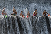 Boys at play (tmeallen) Tags: boys playing havingfun splashingwater cascadingwater tukadundadam hot day sunnyday bali indonesia