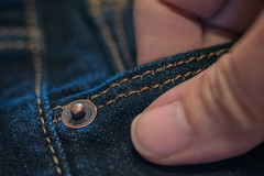 Riveting (www.higbyphotography.com) Tags: cloth macromondays pattern flickrfriday closeup macro fabric texture denim jeans hand fingers thumb