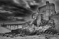 Clevedon Pier BW FR (miroslav.tokarsky) Tags: pentax pentaxart clevedon somerset drama dramatic castle pier sky skies clouds black white bw beach landscape seascape water ocean nature holiday evening night abandoned rural magic bestshotoftheday decay