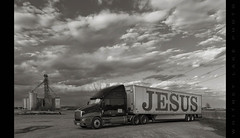 Truckin' for Jesus (Whitney Lake) Tags: 18wheeler truck jesus indiana clouds sky blackandwhite bw grainelevator tractor trailer semi
