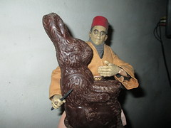 Ardeth Bey / Imhotep the Mummy holding Easter Bunny Rabbit hostage 2017 NYC 4601 (Brechtbug) Tags: boris karloff ardeth bey imhotep mummy holding easter bunny rabbit hostage 2017 monster dusty action figure universal monsters new york city egypt egyptian pharaoh bandage wrapping wrapped ash covered ancient antediluvian archeology museum excavation pyramid sphinx tomb dig sand desert creature its alive scary horror terror halloween fright toy toys shadow twist corpse case mummies sarcophagus sideshow chocolate eeeaster
