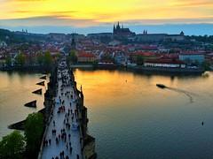 Sunset over Prague - iPhone (Jim Nix / Nomadic Pursuits) Tags: cityscape tower river charlesbridge sunset czechrepublic prague europe travel snapseed iphone