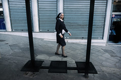 Framed (SHOT BY ViT) Tags: athens street easter nun frame composition streetphotography wide 24mm bus stop candid religion