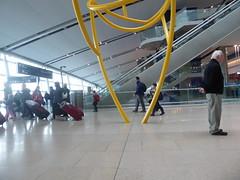 Watching and waiting (seikinsou) Tags: spring kenyatour udp urbandevelopmentprogramme ireland dublin airport sculpture terminal2 arrival yellow