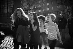 rush to party (omoo) Tags: newyorkcity girls party bw sunlight mother westvillage going rush streetscenes greenwichvillage cellphones horatiostreet childrensparty cobblestonestreet rushtoparty