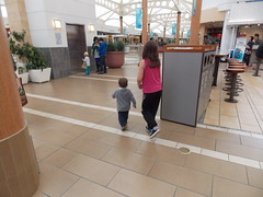 Angelyna Chases Alex (Marina A. Miller) Tags: baby alex rain marina mall shopping fun day play rainy burnaby meredith brentwood angelyna tarya