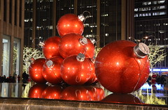 Giant red balls (afagen) Tags: christmas nyc newyorkcity red sculpture newyork night manhattan rockefellercenter ornament radiocitymusichall exxonbuilding 1251avenueoftheamericas