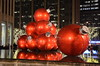 Giant red balls (afagen) Tags: christmas nyc newyorkcity red sculpture newyork night manhattan rockefellercenter ornament radiocitymusichall exxonbuilding 1251avenueoftheamericas