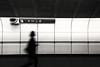 against the grain (bluechameleon) Tags: city urban blackandwhite bw woman motion blur lines silhouette sign vancouver underground movement skytrain bluechameleon artlibre sharonwish bluechameleonphotography