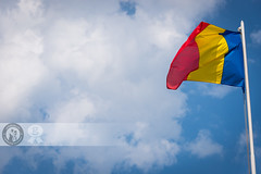 Romanian Flag Against Cloudy Sky (Cristian Sabau) Tags: blue red summer sky cloud yellow horizontal outdoors stream day graphic wind flag unity nobody pole textile romania material patriotism waving cloudscape romanian nationalflag romanianflag clippingpath mangalia colorimage 2013 internationallandmark lowangleview romaniaflag wwwcristiansro
