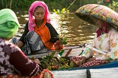 Good Trade (killerturnip) Tags: travel woman fruit river indonesia asian boat wooden asia market muslim hats floating exotic borneo rambutan sellers lok kalimantan traders baintain