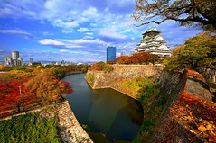 Osaka Castle () in Autumn (TOTORORO.RORO) Tags: travel autumn light color castle fall tourism colors japan wall skyline architecture buildings river season day view cloudy sony wideangle tourist highrise   osaka  alpha popular visitor viewing f4 hdr attractions redleaves nationalgeographic  nex   mirrorless 1018mm nex6 sel1018 pwfall