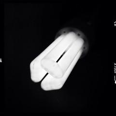 an idea (Jon Downs) Tags: light white black art monochrome bulb digital downs photography grey mono photo jon energy flickr artist photographer phone image gray picture pic photograph saving iphone saver hipstamatic jondowns jondownsjondowns