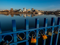 Padlocks & Skyline (In Explore) (Kerry Wright2013) Tags: illinois padlocks skyline buildings water reflection railing blue omdem5markii