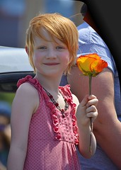 A Flower Girl (swong95765) Tags: girl flower flowergirl smile parade redhead cute adorable smiling observant
