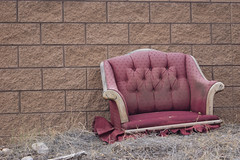 """""""I was the kid who was drawing on tables or removing the legs of furniture"""" (what's_the_frequency) Tags: chair legless waste trash refuse furniture old typennington bullheadcity arizona calnevari sony a65"""
