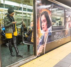 Fantiastic Beasts Subway Car - 3 (UrbanphotoZ) Tags: fantasticbeasts subwaycar subway promotion ad passengers shuttle woman standing smartphone turban boots scarf sweater magicalexposure threatlevel danger s grandcentral timessquare manhattan midtown newyorkcity newyork nyc ny