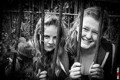 Let Us Out! (BigRedTroll) Tags: bw blackandwhite girl jail monochrome prison trapped unhappy